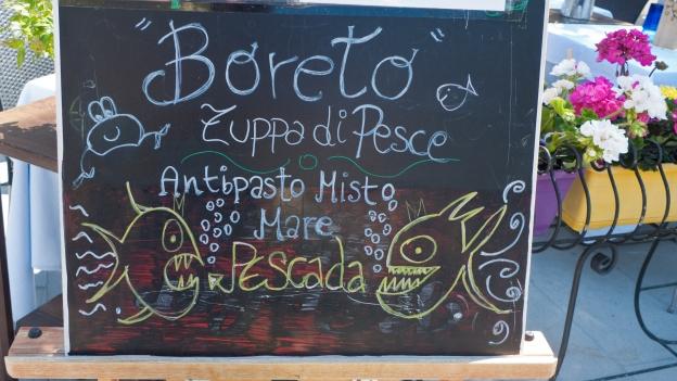 Grado restaurant sign showing fish specialities (Friuli-Venezia-Giulia)