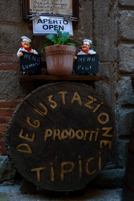 Sign outside a restaurant in Toscana