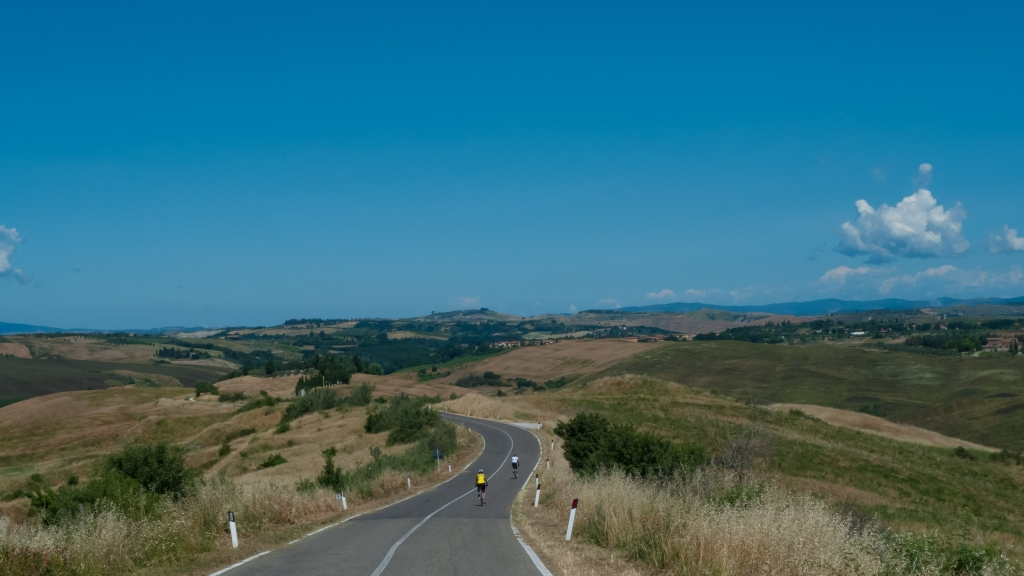 cyclists on the road between Volterra and Siena