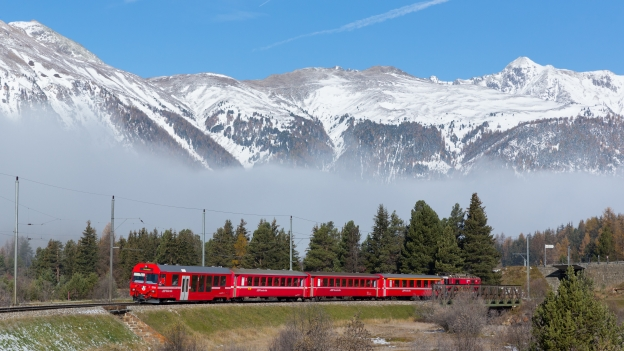 Red RHB train near Pontresina in the Swiss Alps