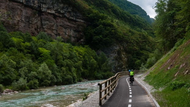 The Lunga Via delle Dolomiti: cyclists riding the new cycleway on the banks of the Piave near Castello Lavazzo