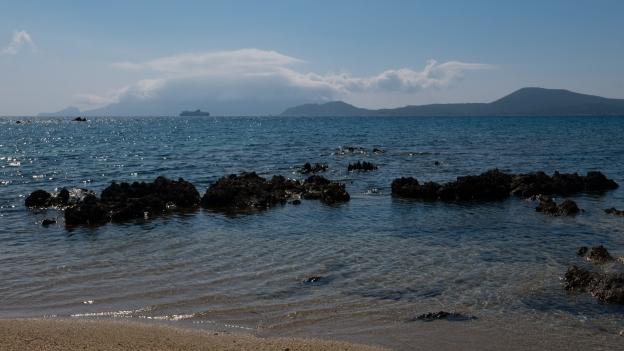 Coast near Olbia: ferry sets out to sea
