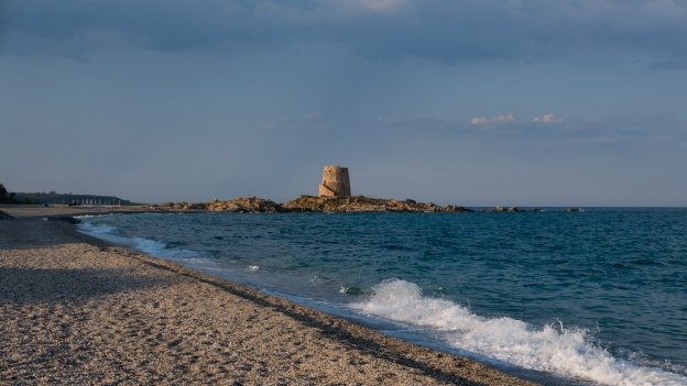 The beach at Bari Sardo with the Torre di Bari Sardo