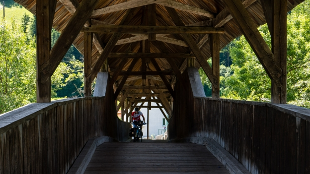 Cyclist on the wooden bridge over the Inn near Landeck
