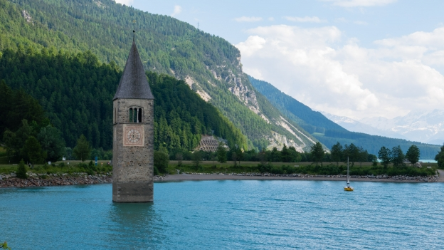 The Reschensee (Lago di Resia) the old church of Graun in Vinschgau (Curon Venosta)