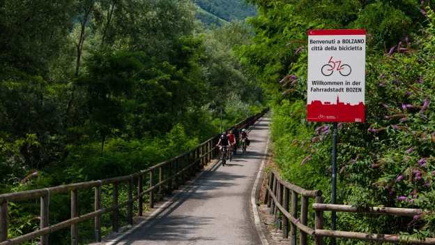 Signs on the Bozen city boundary welcoming cyclists to the city of the bicycle