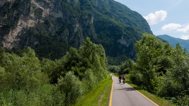 Cyclists on the Valsugana cycleway near Grigno