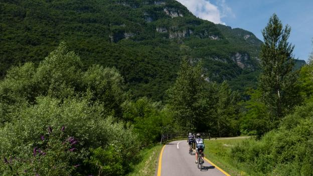 Cyclists on the Ciclabile della Valsugana cycleway near Grigno